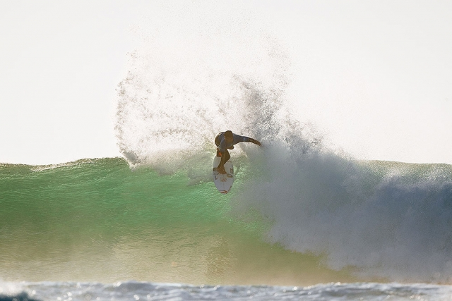 The sun is low but Gabriel Medina is high on wave.